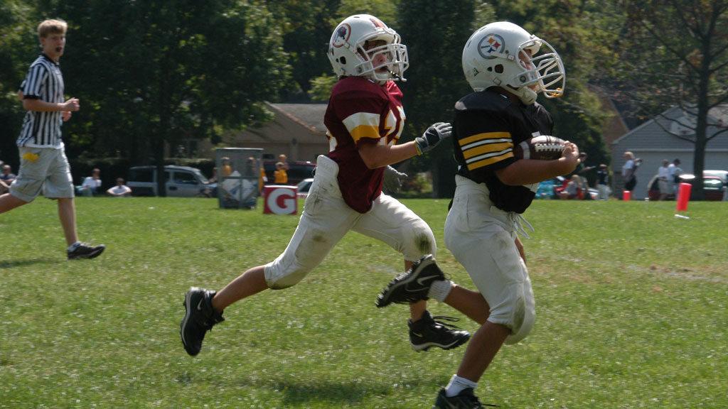 Photo of kids running football