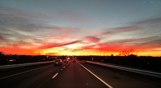 Photo of road leading to sunset.