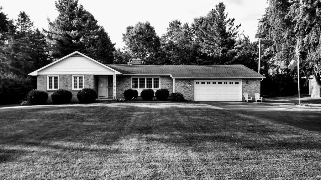 Stylized black and white photo of a house. Nothing fancy