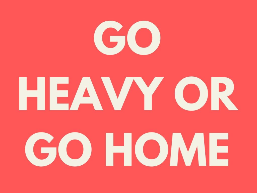 "Sign that says, ""Go Heavy or Go Home"""