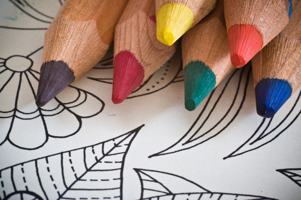 Image of coloring book and colored pencils.